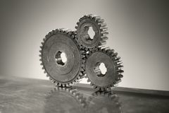 Old Cogs. Monochrome still life of three old cog gear wheels. Short depth-of-field Royalty Free Stock Image