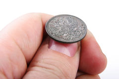Old coin in hand Royalty Free Stock Images