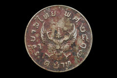 Old coin in Thailand 1974 on black background Stock Image