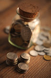 Old coins. On the wooden table, shallow dof royalty free stock photography