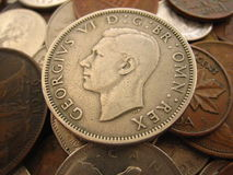 Old Coins. Close up of old coins from around the world royalty free stock photos