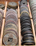 Old coins. Some old Japanese coins in a wooden box royalty free stock photography