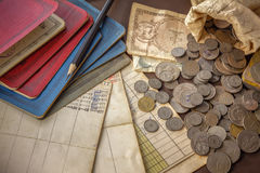 Old coins and bank book on grunge background. Royalty Free Stock Photo