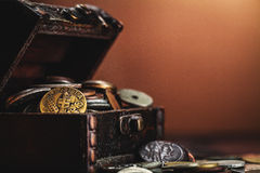 Old coins in chest Stock Image