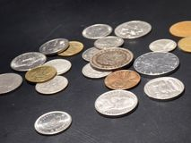 Coins, retro vintage on black background. stock photography