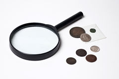 Old Coins and Magnifying Glass Royalty Free Stock Photography