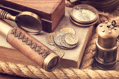 Old coins and nautical accessories Royalty Free Stock Photo