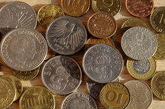 Old coins from nordic and Austria and german and british schelli Royalty Free Stock Photo