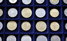 Old coins for numismatic mat. View of the old numismatic coins on the mat Stock Photo