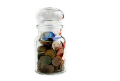 Old coins in old bottle. Isolated on a white background Stock Image