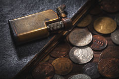Old coins and old lighter Stock Photography