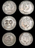 Old ringgit. Old day vintage British Malaya Borneo coins of year 1948 and 1961, that is officially known as the Malaysian Ringgit today (Note that the size of Stock Photos