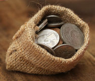 Old coins in sack bag Stock Image