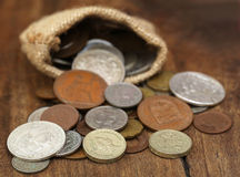 Old coins in sack bag Royalty Free Stock Photos