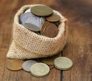 Old coins in sack bag Stock Photos