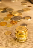 Old Coins stacked Royalty Free Stock Images