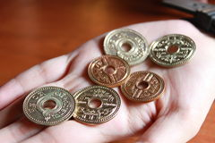 Old coins in Thailand. Old coins in woman left hand Royalty Free Stock Photography
