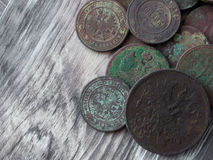 Old coins on wooden background. stock image