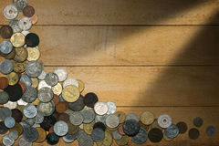 Old Coins on Wooden Background Royalty Free Stock Photo