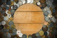 Old Coins on Wooden Background Stock Photography