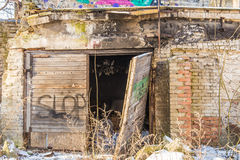 Old collapse garage with wooden door. Soviet time garage that has seen time Royalty Free Stock Images