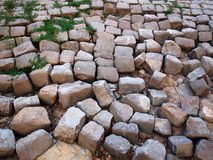 Old collapsed pavement. Old broken pavement from small rough tiles stock image