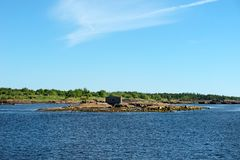 Old collapsing barn on the stone shore. Of the White Sea royalty free stock photography