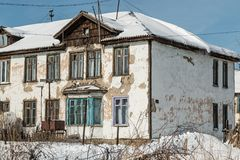 The old collapsing house. Old house built in the early 20th century. gradual destruction of the building Stock Photo