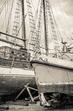 Old collapsing sailboats at the dock, close-up Stock Photography