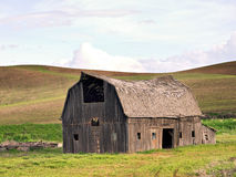 Old collapsing wooden barn Stock Photos