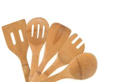 Old collection of wooden spoons isolated on white background royalty free stock images