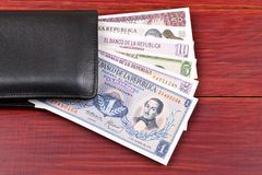 Old Colombian money in the black wallet Royalty Free Stock Image