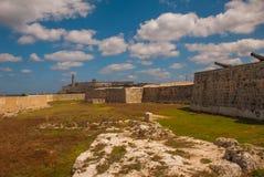 The old colonial castle of San Salvador de la Punta. The Castillo Del Morro lighthouse in Havana. The old fortress Cuba.  Royalty Free Stock Image