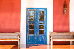Old colonial door. Old blue colonial door somewhere in Mexico Stock Photography