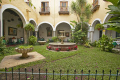 Old Colonial hotel restaurant square with fountain in village of Valladolid, in Yucatan Peninsula, Mexico Stock Photography