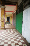 Old colonial passageway. Closed shops along a colonial passage in Cambodia Royalty Free Stock Image