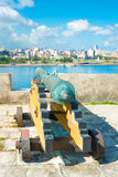 Old colonial spanish cannon aiming at the city of Havana Stock Image