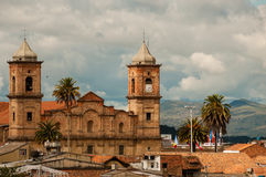 Old colonial stone church with roofs and palm tree Royalty Free Stock Images
