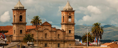 Old colonial stone church with roofs and palm tree Royalty Free Stock Photo
