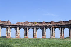Old colonnade. Ruins from brick Stock Photo