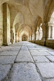 Old colonnaded closter in the Abbaye de Fontenay Stock Photo
