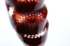 Old color film in a spiral over white background. Old retro color film. stock photo