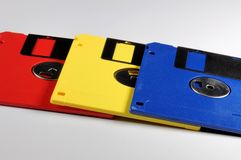 Old color floppy disk. Red, yellow and blue. Royalty Free Stock Image