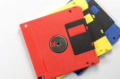 Old color floppy disk. Red, yellow and blue. Stock Image
