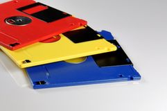 Old color floppy disk. Red, yellow and blue. Royalty Free Stock Photos
