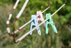 Old color plastic clothespin hanging Royalty Free Stock Photo