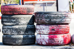 Old color rebber tire put. On playground Royalty Free Stock Image