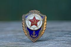 Old color soviet marine icon on gray table. One old color soviet marine icon on a gray table royalty free stock photos