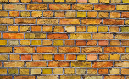 Old color structure of a brick wall. Old color structure of a brick wall with saturated colors Stock Photo