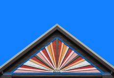 Old color wood panels house wall gable roof and clear blue sky Royalty Free Stock Photos